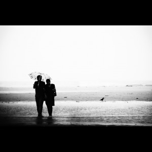 couple on beach with umbrella