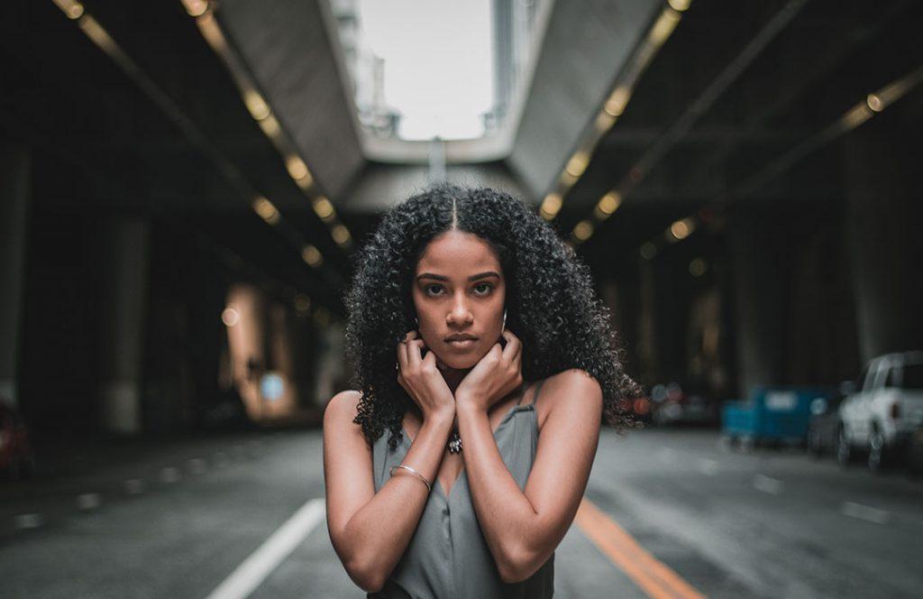 woman in street, posing