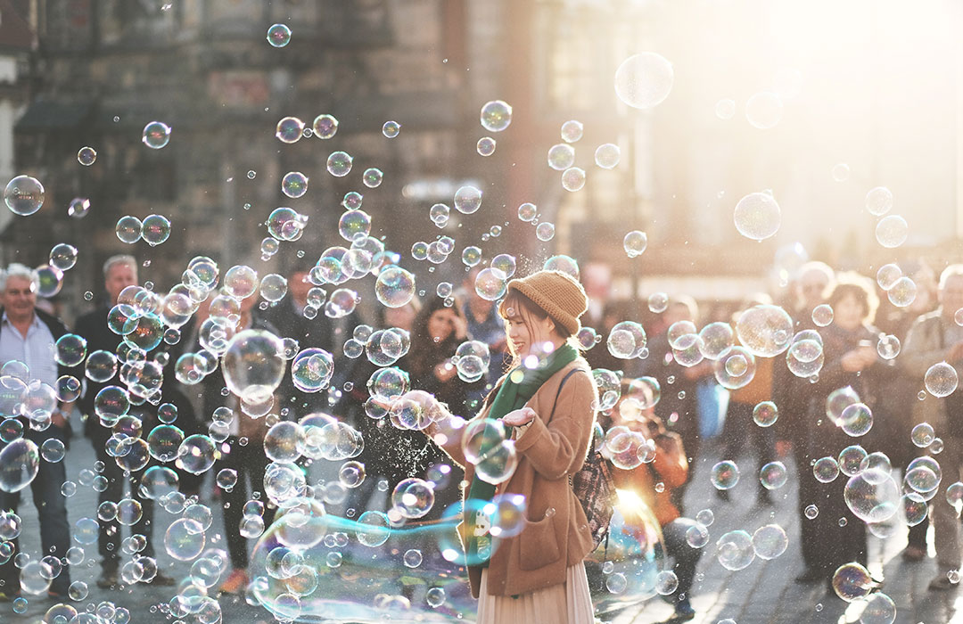 woman outside with bubbles