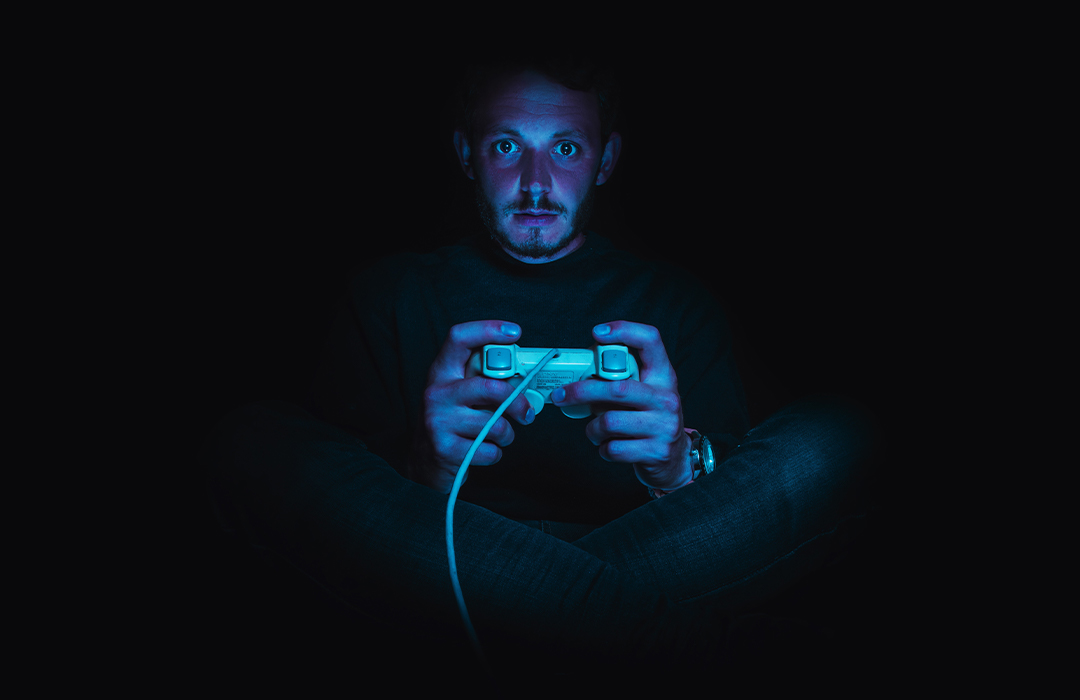 Man gaming in the dark