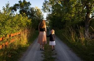 Children walking down gravel road