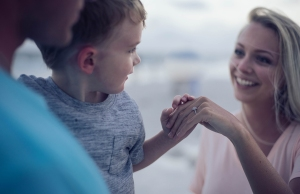 Child holding adult hand