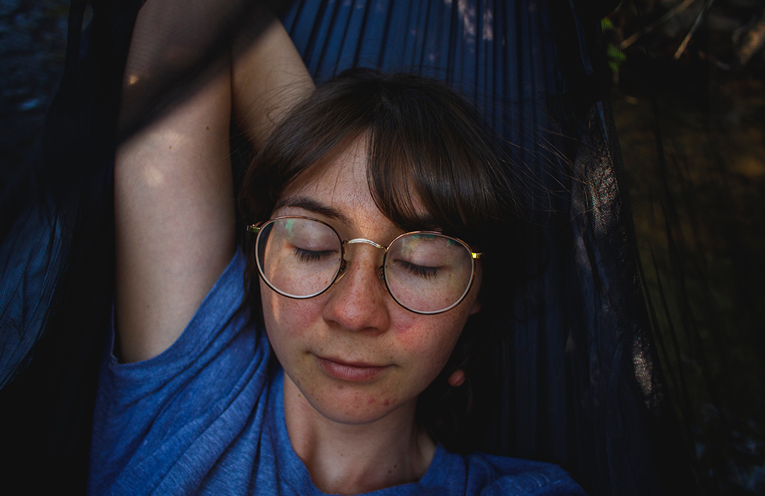 Woman napping on hammock