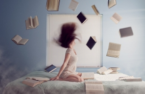 Woman with books flying