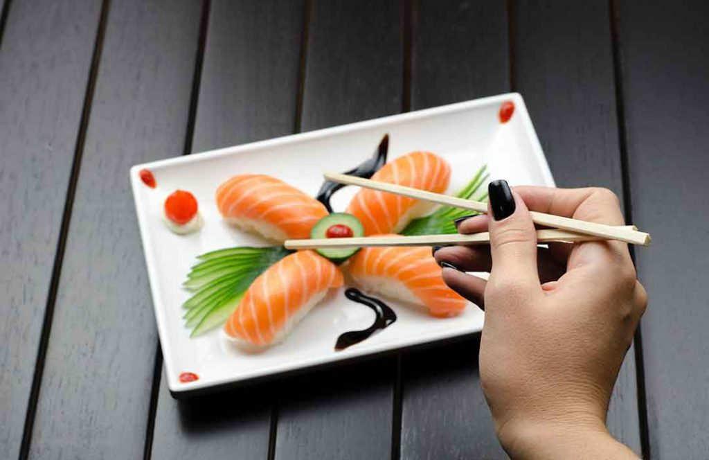 Person eating sushi