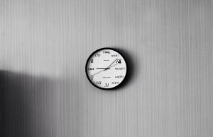 gray wall with white and black clock with math equations