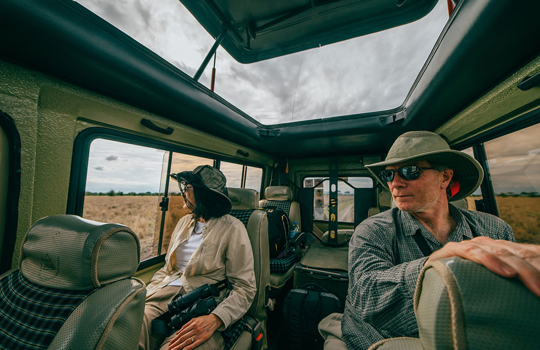 man and woman in safari vehicle