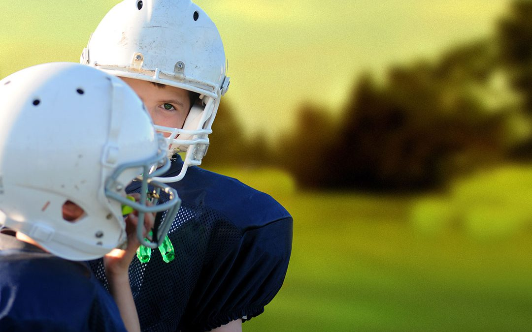 Former professional football player Merril Hoge encourages kids to play sports and parents to support them