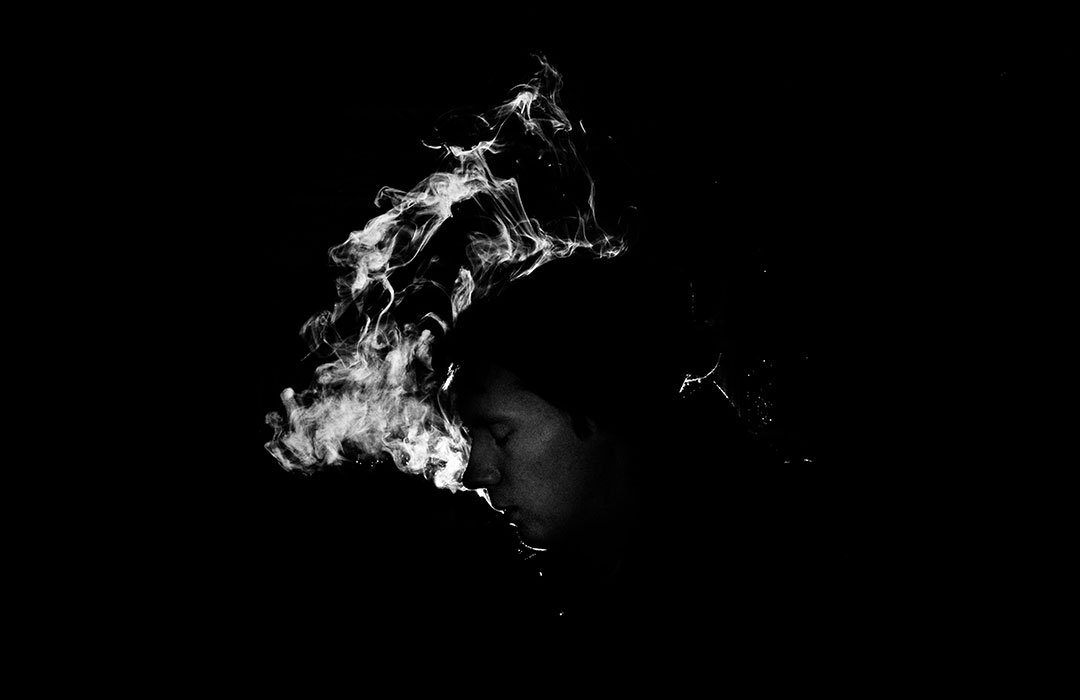 white smoke with shadow of a man