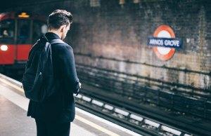 man in black jacket at train station