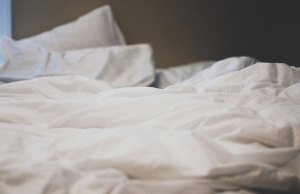 white pillows and blankets
