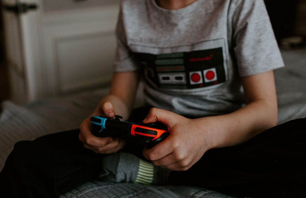 child playing nintendo game