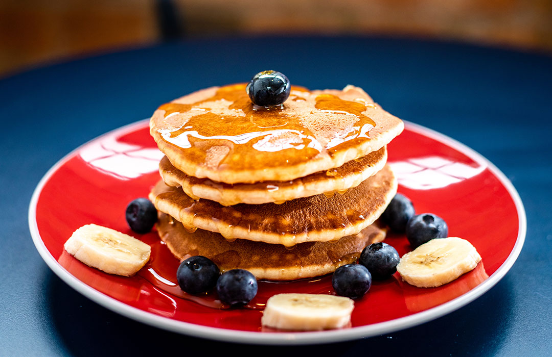 pancakes with fruit on red plate