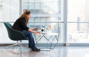 woman sitting in chair working at desk