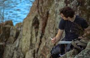 man drawing on mountain