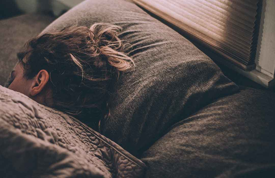 woman sleeping brown pillow and blanket