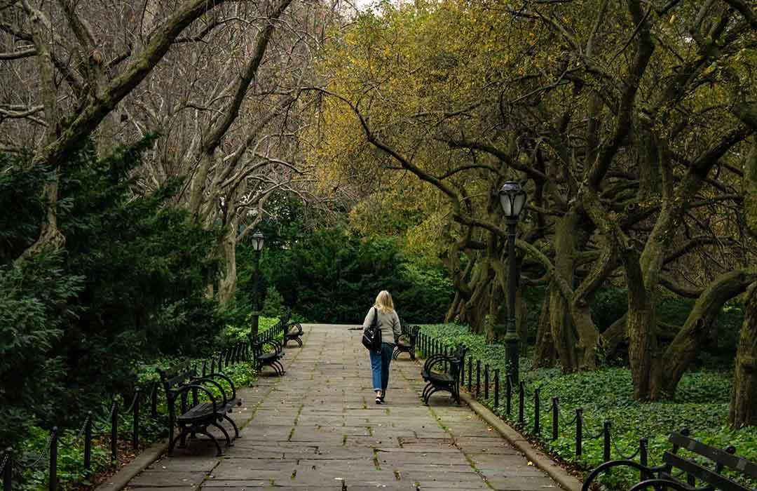 woman walking down stone path