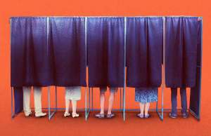 orange background with 5 black curtain stalls with feet
