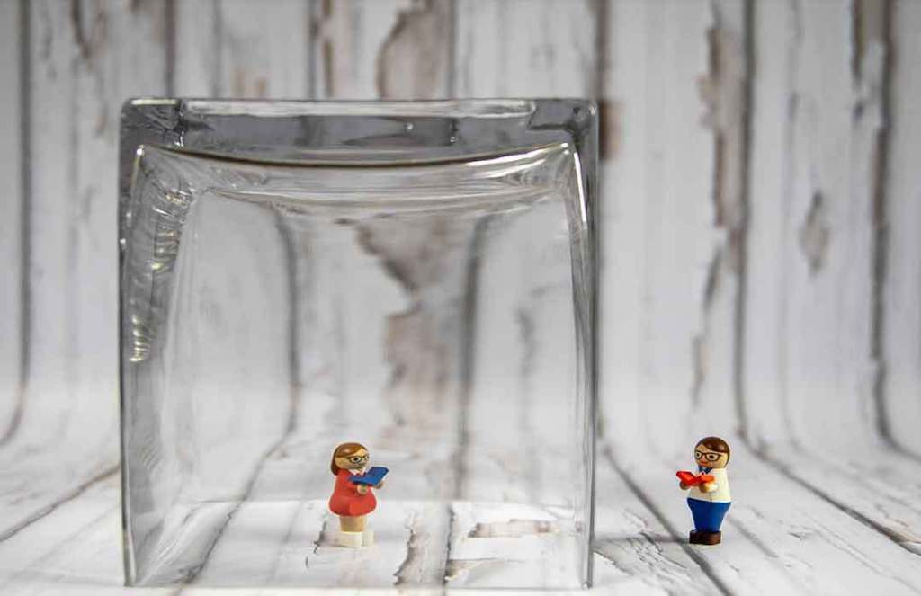 two legos separated by a glass