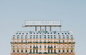 """building with """"everything is canceled"""" billboard"""