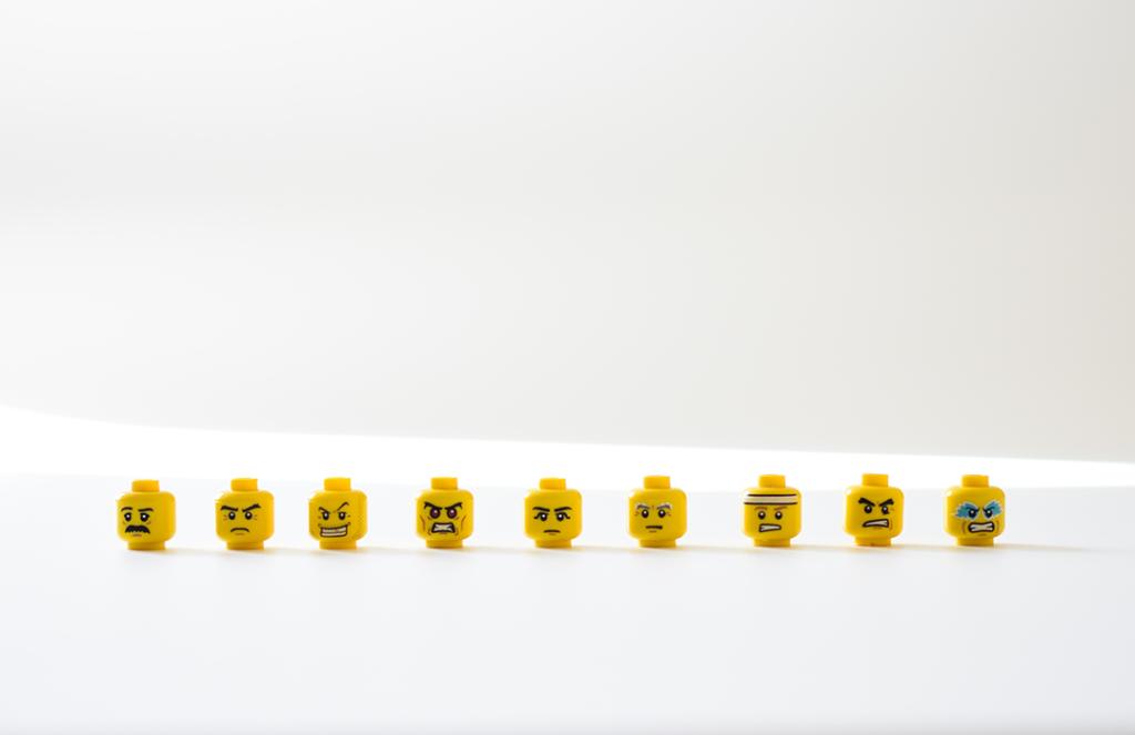 yellow lego faces on white background